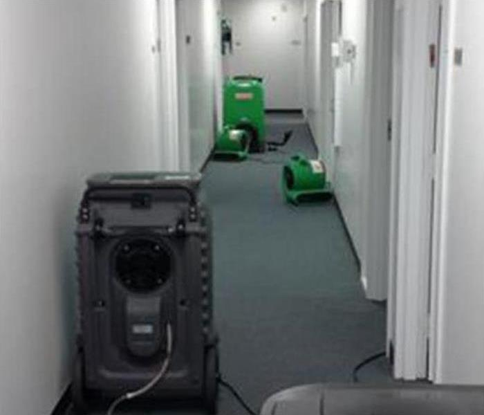 drying equipment on the hallway of an office building
