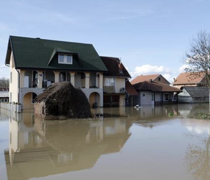 A home surrounded by flooded waters